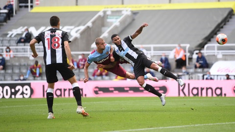 <p>               West Ham's Tomas Soucek, left, and Newcastle's Jamaal Lascelles challenge for the ball during the English Premier League soccer match between Newcastle United and West Ham United at St. James' Park in Newcastle, England, Sunday, July 5, 2020. (Laurence Griffiths/Pool via AP)             </p>