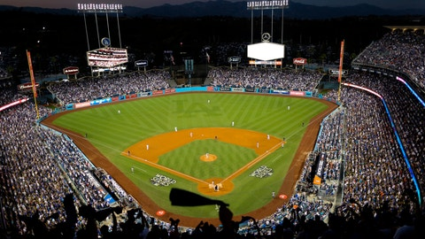 <p>               FILE - In this Oct. 25, 2017, file photo, the Houston Astros and the Los Angeles Dodgers play in Game 2 of the baseball World Series at Dodger Stadium in Los Angeles. There is no Midsummer Classic in baseball this season. There has not even been a regular season game yet because of the coronavirus. Instead of MLB's best gathering this week at Dodger Stadium for the All-Star Game, players are at their home ballparks for summer camp to prepare for the start of the season July 23-24. (AP Photo/Tim Donnelly, File)             </p>