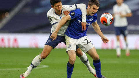 <p>               Tottenham's Son Heung-min, left, duels for the ball with Everton's Seamus Coleman during the English Premier League soccer match between Tottenham Hotspur and Everton FC at the Tottenham Hotspur Stadium in London, England, Monday, July 6, 2020. (Richard Heathcote/Pool via AP)             </p>