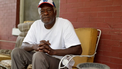 """<p>               Gerald Armstrong recalls his time working for the old Kansas City Athletics as an attendant and ball boy in the visitor's clubhouse as he speaks from the front porch of the home where he grew up and now lives in Kansas City, Mo., on Friday, June 26, 2020. Armstrong is one of more than a dozen Black men who said they were sexually molested by former Red Sox clubhouse manager Donald """"Fitzy"""" Fitzpatrick when they were youths. (AP Photo/Charlie Riedel)             </p>"""