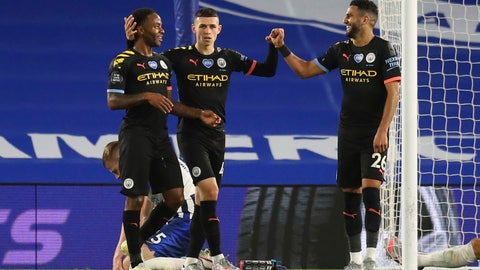 <p>               Manchester City's Raheem Sterling, left, celebrates after scoring his side's fifth goal during the English Premier League soccer match between Brighton and Manchester City at the Falmer stadium in Brighton, England, Saturday, July 11, 2020. (Cath Ivill/Pool via AP)             </p>
