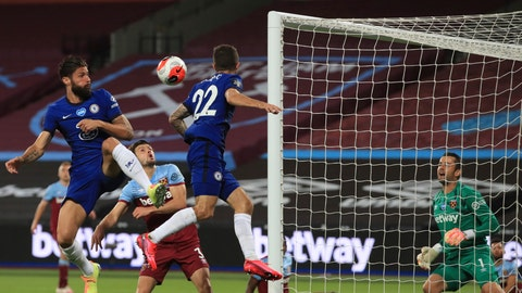 <p>               Chelsea's Olivier Giroud, left heads the ball towards goal during the English Premier League soccer match between West Ham United and Chelsea at the London Stadium in London, Wednesday, July, 1, 2020. (Adam Davy/Pool via AP)             </p>