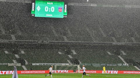 <p>               The board shows the result in heavy rain during the German Bundesliga relegation first leg soccer match between Werder Bremen and 1. FC Heidenheim in Bremen, Germany, Thursday, July 2, 2020. Because of the coronavirus outbreak all soccer matches of the German Bundesliga take place without spectators. (AP Photo/Martin Meissner, Pool)             </p>