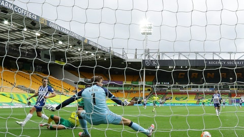 <p>               Brighton's Leandro Trossard, left, scores his side's opening goal past Norwich City's goalkeeper Tim Krul during the English Premier League soccer match between Norwich City and Brighton & Hove Albion at Carrow Road Stadium in Norwich, England, Saturday, July 4, 2020. (Richard Heathcote/Pool Photo via AP)             </p>