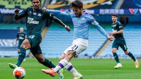 <p>               Manchester City's David Silva shots past Newcastle's Valentino Lazaro, left, during the English Premier League soccer match between Manchester City and Newcastle at the Ethiad Stadium in Manchester, England, Wednesday, July 8, 2020. (Lee Smith/Pool via AP)             </p>