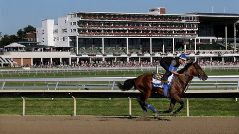 <p>               FILE - In this July 31, 2015, file photo, people watch as Triple Crown winner American Pharoah with Jorge Alvarez up trains at Monmouth Park in Oceanport, N.J. With the opening of the thoroughbred season at Monmouth Park just days away, chief executive Dennis Drazin knows the track will be beating the odds by just breaking even. The coronavirus pandemic has idled the New Jersey Shore track for two months. (AP Photo/Mel Evans, File)             </p>