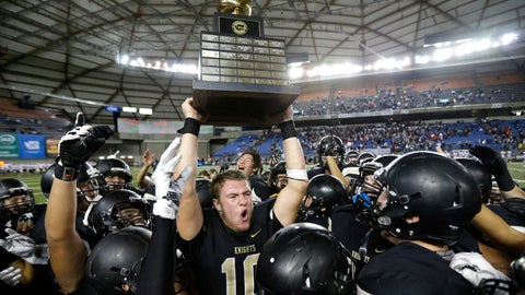 <p>               FILE - In this Dec. 3, 2016 file photo, Royal quarterback Kaden Jenks (10) celebrates with the trophy after Royal beat Connell in the Washington Div. 1A high school football championship in Tacoma, Wash. The overwhelming uncertainty of whether high school sports can go forward in the fall of 2020 amidst the continued COVID-19 pandemic is a constant refrain among administrators and decision makers as the clock ticks closer to the start of the 2020-21 school year with little clarity in place for an obvious and safe path moving forward for athletics. (AP Photo/Ted S. Warren, File)             </p>