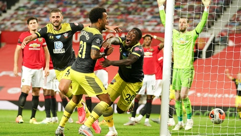 <p>               Southampton's Michael Obafemi, centre,celebrates after scoring his team's second goal during the English Premier League soccer match between Manchester United and Southampton at Old Trafford in Manchester, England, Monday, July 13, 2020. (AP Photo/Dave Thompson,Pool)             </p>