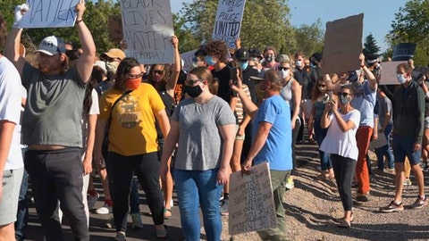 <p>               In this June 3, 2020, photo provided by Idaho State Athletics, people walk during a unity march, in Pocatello, Idaho. A strong connection between law enforcement and Idaho State student-athletes set the stage for the peaceful unity march. (Jarius Fields/Idaho State Athletics via AP)             </p>