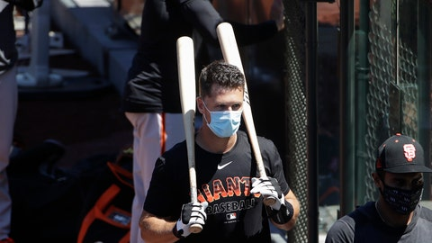 <p>               San Francisco Giants' Buster Posey carries his bats during a baseball practice in San Francisco, Sunday, July 5, 2020. (AP Photo/Jeff Chiu)             </p>