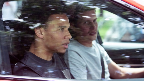 <p>               FC Bayern soccer club newcomer Leroy Sane, left, sits in a car as he leaves the FC Bayern training ground in Munich, Germany, July 2, 2020. FC Bayern newcomer Sane arrived in Munich the day before. (Matthias Balk/dpa via AP)             </p>
