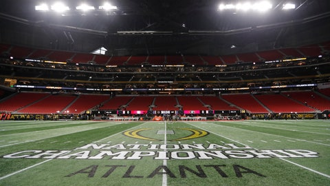 <p>               FILE - In this Jan. 8, 2018, file photo, the championship logo is seen on the field at Mercedes-Benz Stadium before the NCAA college football playoff championship game between Georgia and Alabama in Atlanta. There are more bowl games scheduled for the coming season than ever before in major college football: 42, not including the College Football Playoff championship. College football leaders are in the process of piecing together plans to attempt to play a regular season during the COVID-19 pandemic. If it is even possible, everyone anticipates there will be disruptions, added expenses and loads of stress just to get through it.(AP Photo/David Goldman)             </p>