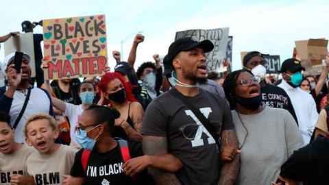 <p>               Portland Trailblazers' Damian Lillard, second from right, joins other demonstrators in Portland, Ore., during a protest against police brutality and racism sparked by the death of George Floyd, who died May 25 after being restrained by police in Minneapolis. (AP Photo/Craig Mitchelldyer)             </p>