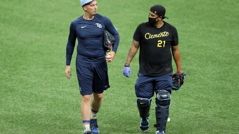 <p>               Tampa Bay Rays' Blake Snell, left, talks with bullpen catcher Jean Ramirez during baseball practice Friday July 3, 2020, in St. Petersburg, Fla. Snell made headlines in May when he said he opposed the idea of players taking further pay reductions to start the season during a pandemic — that it was not worth the health risk. But he said Friday it wasn't difficult to start playing again after the players' agreement with Major League Baseball included their full pro-rated salaries. (AP Photo/Mike Carlson)             </p>
