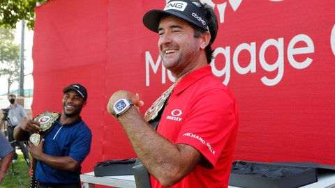 <p>               Bubba Watson and Harold Varner III, left, show off the winner's belts after their win in a nine-hole exhibition against Jason Day and Wesley Bryan ahead of the Rocket Mortgage Classic golf tournament, Wednesday, July 1, 2020, at the Detroit Golf Club in Detroit. (AP Photo/Carlos Osorio)             </p>