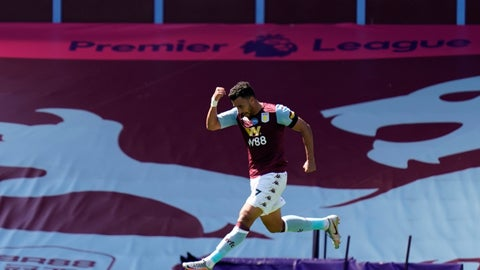 <p>               Aston Villa's Trezeguet celebrates after scoring his side's first goal during the English Premier League soccer match between Aston Villa and Crystal Palace at Villa Park in Birmingham, England, Sunday, July 12, 2020. (Tim Keeton/Pool Photo via AP)             </p>