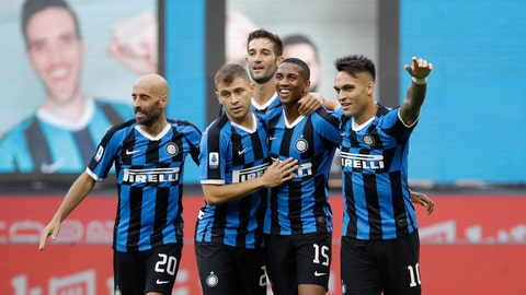 <p>               Inter Milan's Ashley Young, second from right, celebrates with his teammates after scoring his side's opening goal during the Serie A soccer match between Inter Milan and Brescia at the San Siro Stadium, in Milan, Italy, Wednesday, July 1, 2020. (AP Photo/Luca Bruno)             </p>