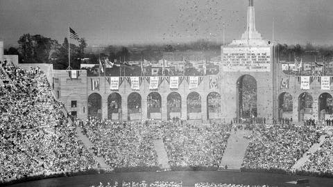 <p>               FILE - In this July 30, 1932, file photo, doves are released during the opening ceremony for the Tenth Olympiad at Los Angeles. The athletes of various countries are shown on the field while the Olympic beacon and the entrance to the stadium is shown in the background. (AP Photo/File)             </p>