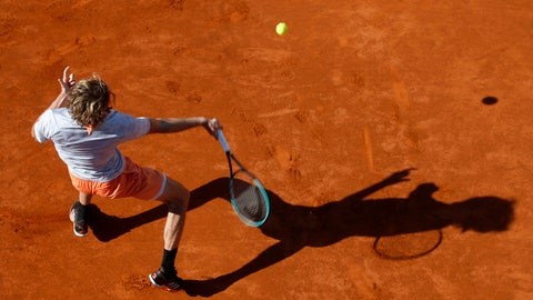 <p>               Germany's Alexander Zverev returns the ball to Serbia's Novak Djokovic during their match of the Adria Tour charity tournament in Belgrade, Serbia, Sunday, June 14, 2020. (AP Photo/Darko Vojinovic)             </p>