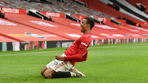 <p>               Manchester United's Mason Greenwood celebrates after scoring a goal during the English Premier League soccer match between Manchester United and Bournemouth at Old Trafford stadium in Manchester, England, Saturday, July 4, 2020. (Peter Powell/Pool via AP)             </p>