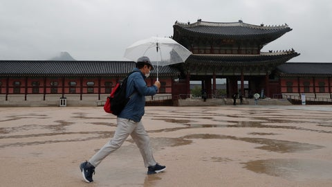 <p>               A man wearing a face mask to help protect against the spread of the new coronavirus walks at the Gyeongbok Palace, one of South Korea's well-known landmarks, in Seoul, South Korea, Wednesday, July 22, 2020. Just days after South Korean officials hopefully declared the country's COVID-19 epidemic was coming under control, health authorities reported dozens of new cases following a dual rise in local transmissions and imported infections. (AP Photo/Lee Jin-man)             </p>