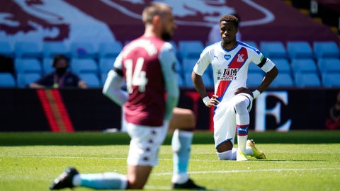 <p>               Crystal Palace's Wilfried Zaha takes a knee in support of the Black Lives Matter movement before the English Premier League soccer match between Aston Villa and Crystal Palace at Villa Park in Birmingham, England, Sunday, July 12, 2020. (Tim Keeton/Pool Photo via AP)             </p>