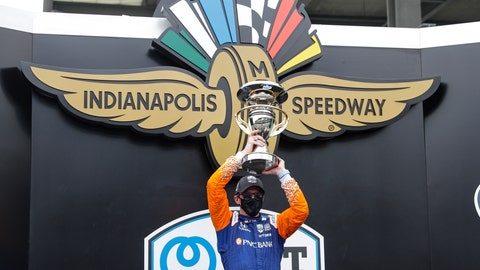 <p>               Race driver Scott Dixon, of New Zealand, celebrates with the trophy after winning the IndyCar auto race at Indianapolis Motor Speedway in Indianapolis, Saturday, July 4, 2020. (AP Photo/Darron Cummings)             </p>