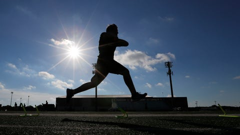 <p>               FILE - A student athlete runs a drill during a strength and conditioning camp at Arlington Martin High School Thursday, June 18, 2020, in Arlington, Texas. Texas will play high school football this fall, but some of it will be delayed, fans will be limited and masks will be required as the state fights a surge in new coronavirus cases, hospitalizations and fatalities. The University Interscholastic League on Tuesday, July 21, 2020 released its guidelines for Texas public high school fall sports, pushing back the start of the football and volleyball seasons for the largest schools by one month into late September and extending the football championships for those schools into January. (AP Photo/LM Otero, file)             </p>