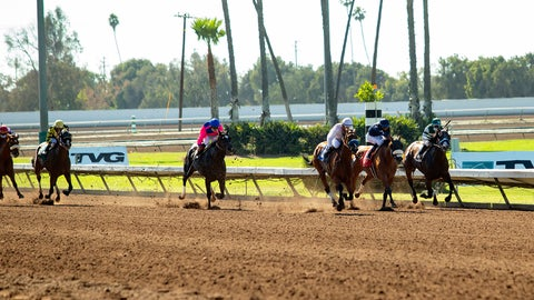 <p>               In this image provided by Benoit Photo, Sneaking Out, third from right, with Martin Garcia aboard, wins the Grade II, $200,000 Great Lady M Stakes horse race Saturday, July 4, 2020, at Los Alamitos Race Course in Cypress, Calif. (Benoit Photo via AP)             </p>