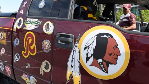 "<p>               Rodney Johnson of Chesapeake, Va., stands with his truck outside FedEx Field in Landover, Md., Monday, July 13, 2020. The Washington NFL franchise announced Monday that it will drop the ""Redskins"" name and Indian head logo immediately, bowing to decades of criticism that they are offensive to Native Americans. (AP Photo/Susan Walsh)             </p>"