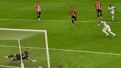 <p>               Real Madrid's Sergio Ramos, right, scores the opening goal from a penalty shoot during the Spanish La Liga soccer match between Athletic Club and Real Madrid at the San Manes stadium in Bilbao, Spain, Sunday, July 5, 2020. (AP Photo/Alvaro Barrientos)             </p>