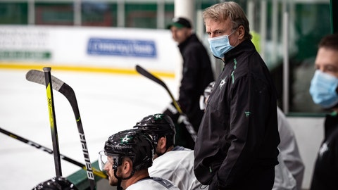 <p>               In this photo provided by the Dallas Stars NHL hockey team, interim head coach Rick Bowness watches practice in Frisco, Texas, Tuesday, July 14, 2020. Bowness, 65, coached from behind the bench the first couple of days of Dallas Stars training camp before lacing up his skates and getting on the ice. Montreal's 60-year-old Claude Julien, Edmonton's 58-year-old Dave Tippett and others are confident in the NHL's protocols as older, more at-risk people during the COVID-19 pandemic. (Jeff Toates/Dallas Stars via AP)             </p>
