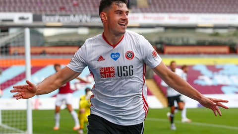 <p>               Sheffield United's John Egan celebrates after scoring his side's opening goal during the English Premier League soccer match between Burnley and Sheffield United, at Turf Moor Stadium in Burnley, England, Sunday, July 5, 2020. (Clive Brunskill/Pool Photo via AP)             </p>