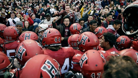 <p>               FILE - In this Nov. 17, 2018, file photo, Harvard players, students and fans celebrate their 45-27 win over Yale after an NCAA college football game at Fenway Park in Boston. Harvard defeated Yale. The Ivy League has canceled all fall sports because of the coronavirus pandemic. (AP Photo/Charles Krupa, File)             </p>