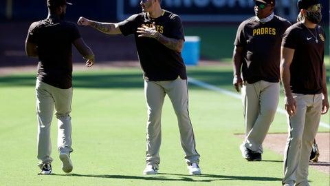 <p>               San Diego Padres third baseman Manny Machado, center, jokes with teammate second baseman Jurickson Profar, left, during baseball training at Petco Park Friday, July 3, 2020, in San Diego. (AP Photo/Gregory Bull)             </p>