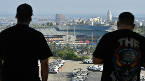 <p>               Los Angeles Dodgers fans take in the view near Dodger Stadium on Wednesday, June 24, 2020, in Los Angeles. By the time Major League Baseball returns in late July, it will have been more than four months since teams last played. The season is now going to be a 60-game sprint to the finish, held in ballparks without fans and featuring some unusual rules. (AP Photo/Mark J. Terrill)             </p>