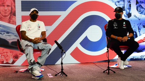 <p>               Lewis Hamilton of Great Britain and Mercedes GP and Valtteri Bottas of Finland and Mercedes GP talk in the Drivers Press Conference during previews ahead of the F1 Grand Prix of Great Britain at Silverstone on Thursday, July 30, 2020 in Silverstone, England. (AP Photo/Mario Renzi via Getty Images)             </p>