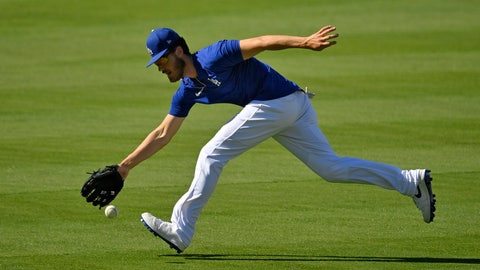 <p>               Los Angeles Dodgers center fielder Cody Bellinger fields a ball during the restart of baseball spring training Friday, July 3, 2020, in Los Angeles. (AP Photo/Mark J. Terrill)             </p>