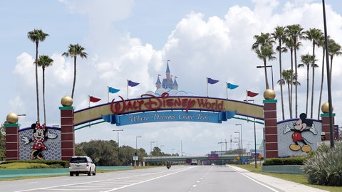 """<p>               Cars drive under a sign greeting visitors near the entrance to Walt Disney World, Thursday, July 2, 2020, in Lake Buena Vista, Fla. Despite a huge surge of Floridians testing positive for the new coronavirus in recent weeks, Magic Kingdom and Animal Kingdom, two of Disney World's four parks are reopening Saturday, July 11. When they do, visitors to """"The Most Magical Place on Earth"""" will find new rules in place. (AP Photo/John Raoux)             </p>"""