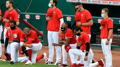 <p>               Cincinnati Reds' Phillip Ervin, left, Joey Votto, left middle, Amir Garrett, middle, and Alex Blandino, right, kneel during the national anthem prior to an exhibition baseball game against the Detroit Tigers at Great American Ballpark in Cincinnati, Tuesday, July 21, 2020. (AP Photo/Aaron Doster)             </p>