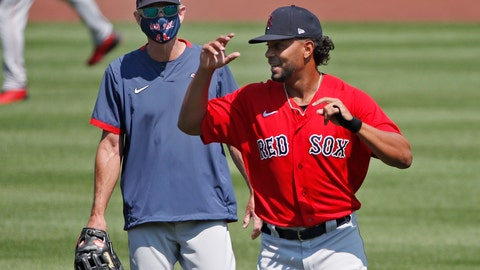<p>               Boston Red Sox's Xander Bogaerts, right, runs past Interim Manager Ron Roenicke during baseball training camp at Fenway Park, Tuesday, July 7, 2020, in Boston. (AP Photo/Elise Amendola)             </p>