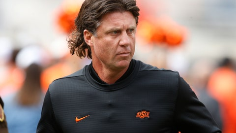 """<p>               FILE - In this Oct. 6, 2018, file photo, Oklahoma State football coach Mike Gundy runs onto the field before the team's NCAA college football game against Iowa State in Stillwater, Okla. Mike Holder, Oklahoma State's athletic director, said late Thursday, July 2, 2020, an internal review had found """"no sign or indication of racism"""" in the football program under Gundy after a number of players raised concerns. (AP Photo/Sue Ogrocki, File)             </p>"""