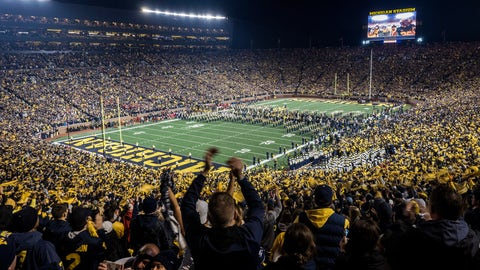 """<p>               FILE - In this Oct. 13, 2018, file photo, fans cheer as the Michigan team takes the field at Michigan Stadium for an NCAA college football game against Wisconsin in Ann Arbor, Mich. The University of Michigan says fewer fans, if any, will attend games at """"The Big House"""" if the Wolverines play college football games this year. The athletic department says a final decision will be made after conferring with medical experts, the school's leadership and the Big Ten Conference, along with government officials and agencies. (AP Photo/Tony Ding, File)             </p>"""