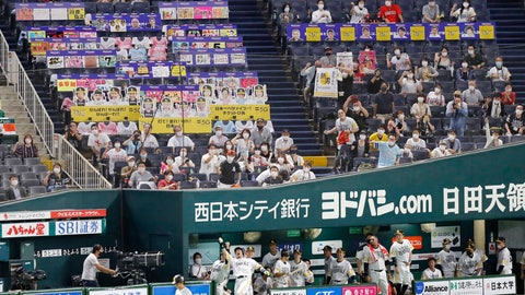 <p>               Fans wearing face masks cheer as SoftBank Hawks' Nobuhiro Matsuda, center, celebrates after hitting a solo home run against Rakuten Golden Eagles in the second inning of a regular season baseball game in Fukuoka, southwestern Japan, Friday, July 10, 2020. Japan's professional baseball league began allowing up to 5,000 fans into the games on Friday, or 50% of the stadium capacity - whichever is smaller. Officials hope to allow the stadiums to be filled to 50% capacity beginning on Aug. 1. (Kyodo News via AP)             </p>