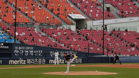 <p>               Fans wearing face masks to help protect against the spread of the new coronavirus watch the KBO league game between Doosan Bears and LG Twins in Seoul, South Korea, Sunday, July 27, 2020. Masked fans hopped, sang and shouted cheering slogans in baseball stadiums in South Korea on Sunday as authorities began bringing back spectators in professional sports games amid the coronavirus pandemic. (AP Photo/Ahn Young-joon)             </p>