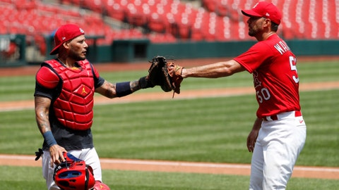 St. Louis Cardinals pitcher Adam Wainwright, right, is congratulated by catcher Yadier Molina after throwing a simulated inning during baseball practice at Busch Stadium Sunday, July 5, 2020, in St. Louis. (AP Photo/Jeff Roberson)