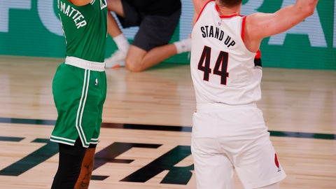<p>               Boston Celtics' Jayson Tatum (0) shoots against Portland Trail Blazers' Mario Hezonja (44) during an NBA basketball game Sunday, Aug. 2, 2020, in Lake Buena Vista, Fla. (Mike Ehrmann/Pool Photo via AP)             </p>