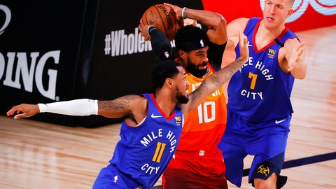 <p>               Utah Jazz's Mike Conley (10) rebounds against Denver Nuggets' Monte Morris (11) and Mason Plumlee (7) during the third quarter of an NBA basketball game Saturday, Aug. 8, 2020, in Lake Buena Vista, Fla. (Kevin C. Cox/Pool Photo via AP)             </p>