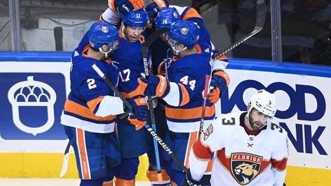 <p>               New York Islanders left wing Matt Martin (17) celebrates his goal with teammates as Florida Panthers defenceman Keith Yandle (3) skates away during the second period of an NHL Stanley Cup playoff hockey game in Toronto, Tuesday, Aug. 4, 2020. (Nathan Denette/The Canadian Press via AP)             </p>