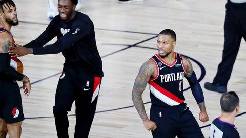 <p>               Portland Trail Blazers guard Damian Lillard (0) celebrates after their win over the Dallas Mavericks in an NBA basketball game Tuesday, Aug. 11, 2020, in Lake Buena Vista, Fla. (Kim Klement/Pool Photo via AP)             </p>